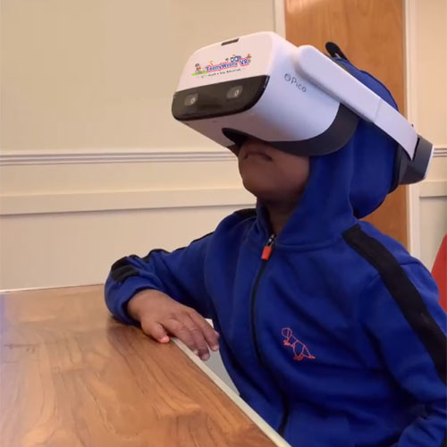 Boy with headset preparing for a visit